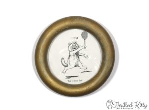 'The Tennis Fan' by Louis Wain | Vintage Circular Framed Print